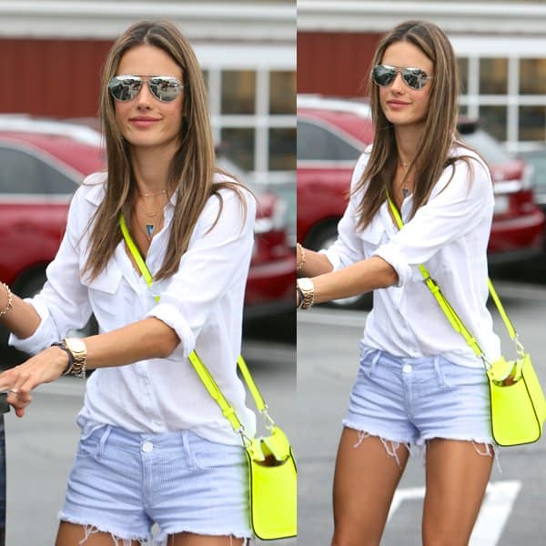 Alessandra Ambrosio wears a white button-up blouse while leaving Calypso at Brentwood Country Mart in Los Angeles