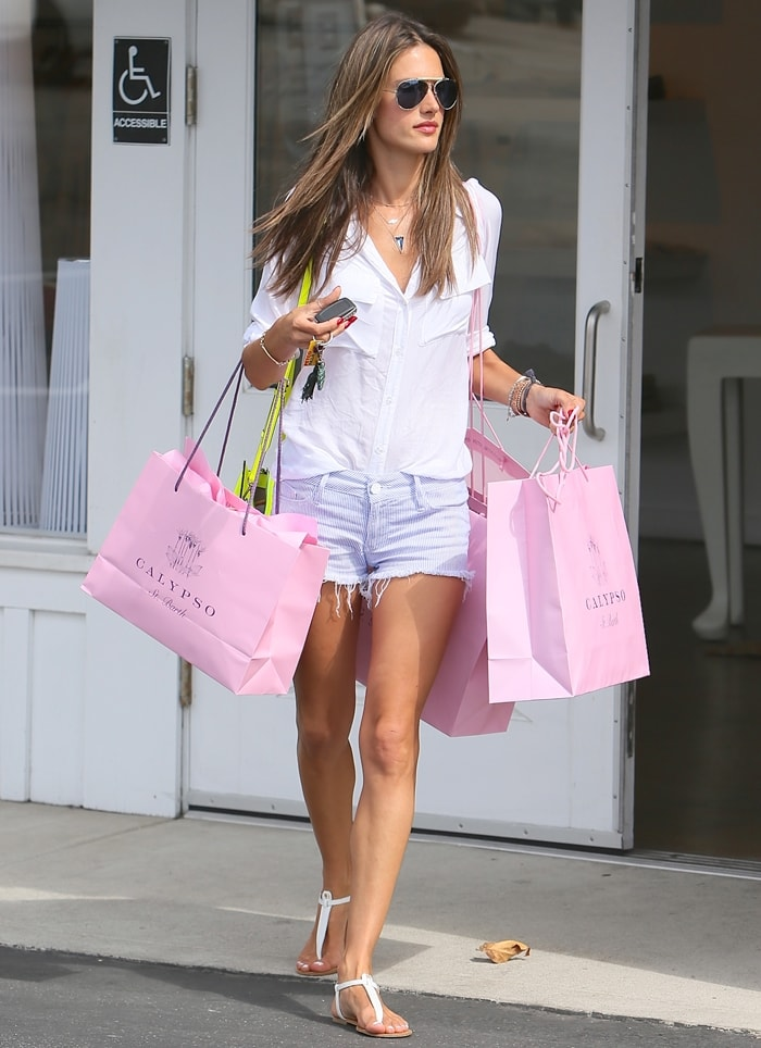 Alessandra Ambrosio flaunts her legs in pinstriped cutoffs with slightly frayed hems from Black Orchid