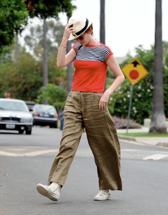 Anne Hathaway wearing big baggy trousers and a fedora hat while walking to a friend's house in California on July 10, 2013
