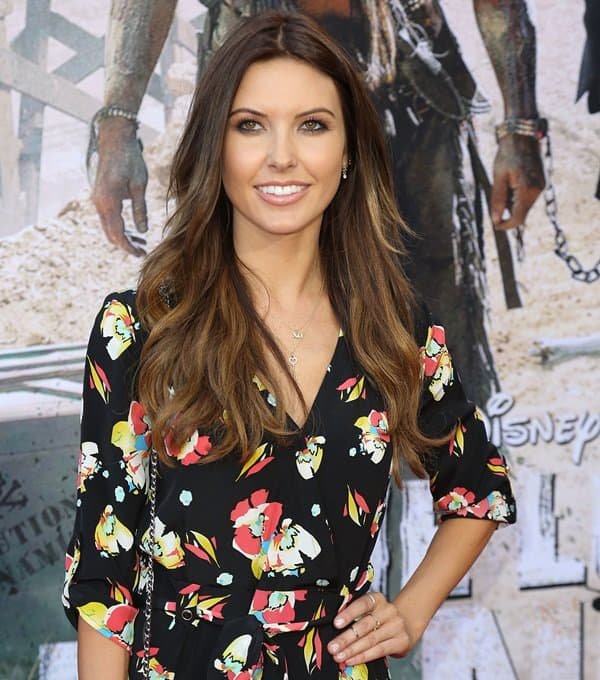 Audrina Patridge wearing a summery floral romper from Yumi Kim