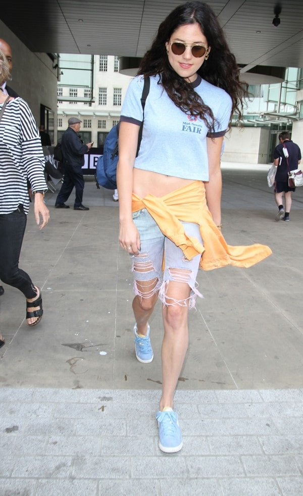 Eliza Doolittle wearing shoes in an odd manner while exiting Radio 1 in London on July 20, 2013