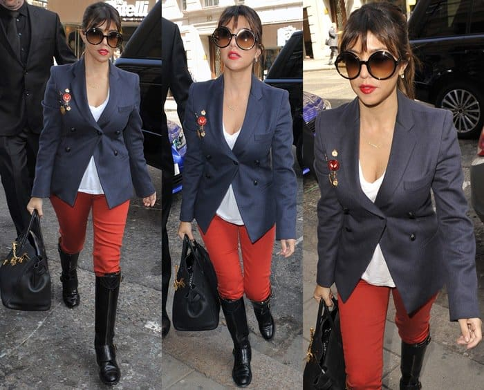Kourtney Kardashian wearing red pants with knee-high boots