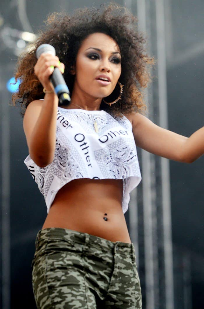 Leigh-Anne Pinnock flaunts her belly button piercing jewelry in a printed bandana vest top