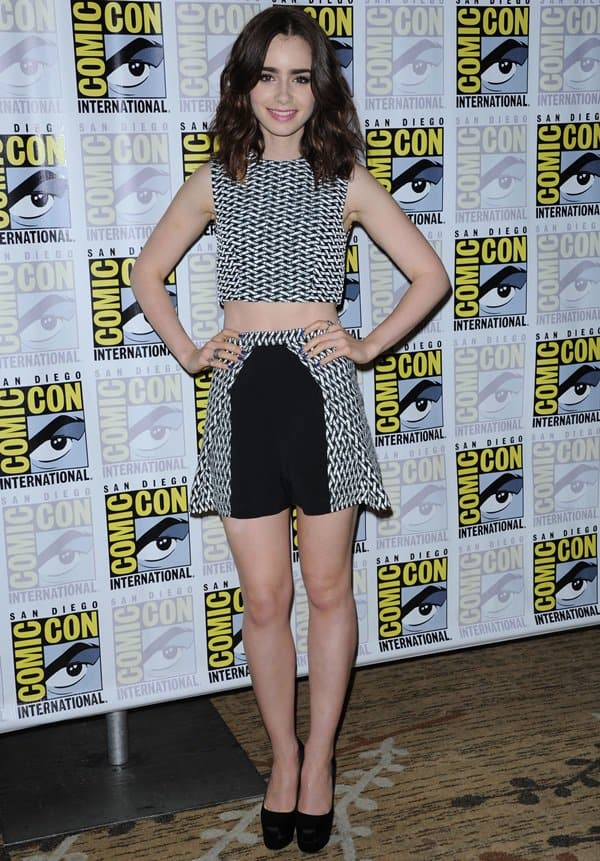 Lily Collins posed for the cameras in a matching black-and-white ensemble by Paper London