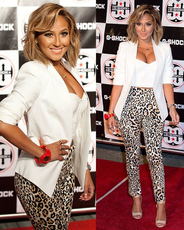 Adrienne Bailon styled her leopard print pants with a white blazer