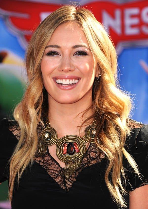 Hilary Duff wearing a pretty Maje playsuit in black