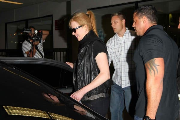 Nicole Kidman being ushered into an awaiting car by her bodyguards after arriving at Los Angeles International Airport (LAX) on August 12, 2013
