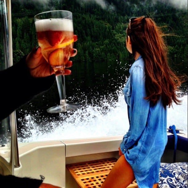Selena Gomez on a boat in a Kyley Tencel denim tunic dress from Rails