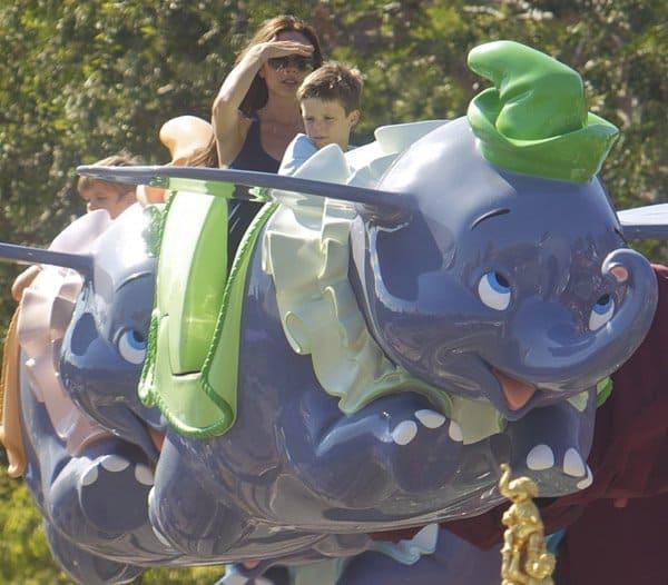 Victoria Beckham enjoys the aerial carousel-style Dumbo the Flying Elephant ride