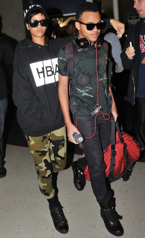 Rihanna and her younger brother Rajad arriving at Los Angeles International Airport in Los Angeles on August 27, 2013