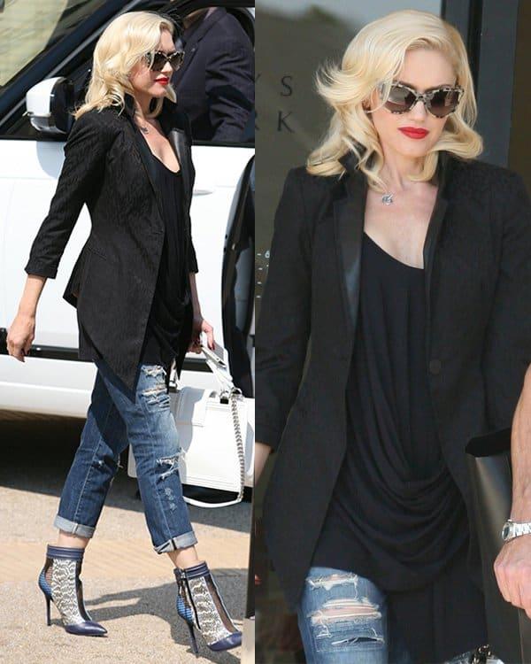 Gwen Stefani wears ripped boyfriend jeans while leaving Barneys New York in Beverly Hills