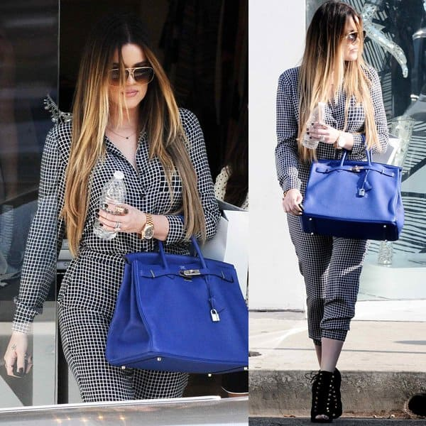 Khloe Kardashian sported a windowpane plaid jumpsuit, which she styled with a pair of black booties by Giuseppe Zanotti