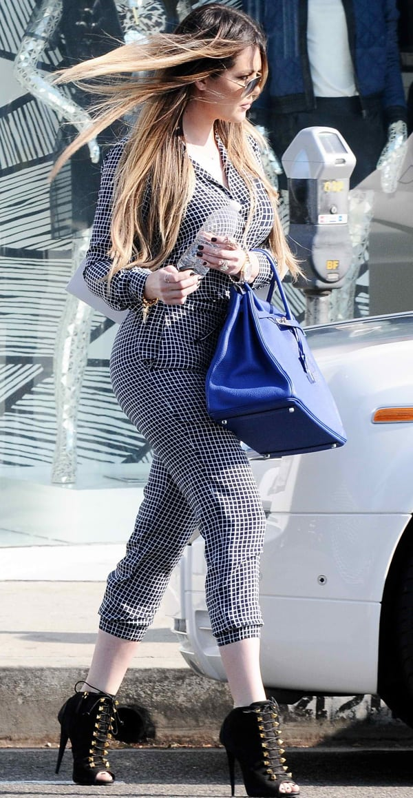 Khloe Kardashian showing off her hard-earned slimmer physique in a plaid jumpsuit by Theory