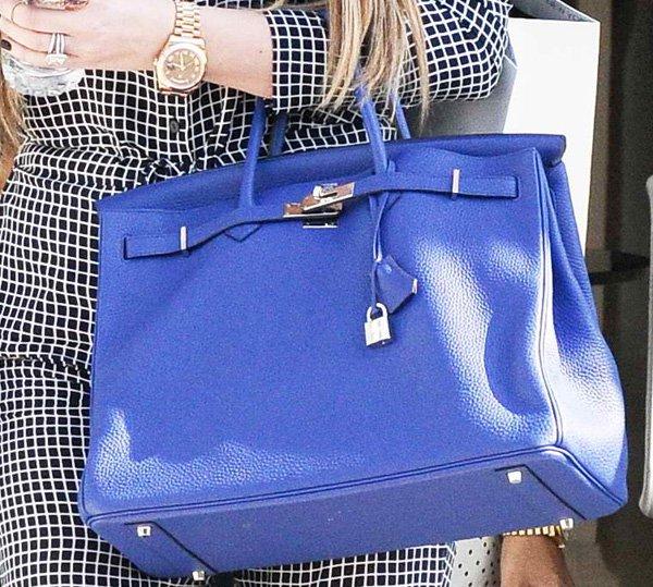 Khloe Kardashian carrying a gorgeous blue Hermés bag