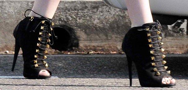 Khloe Kardashian wearing black booties by Giuseppe Zanotti