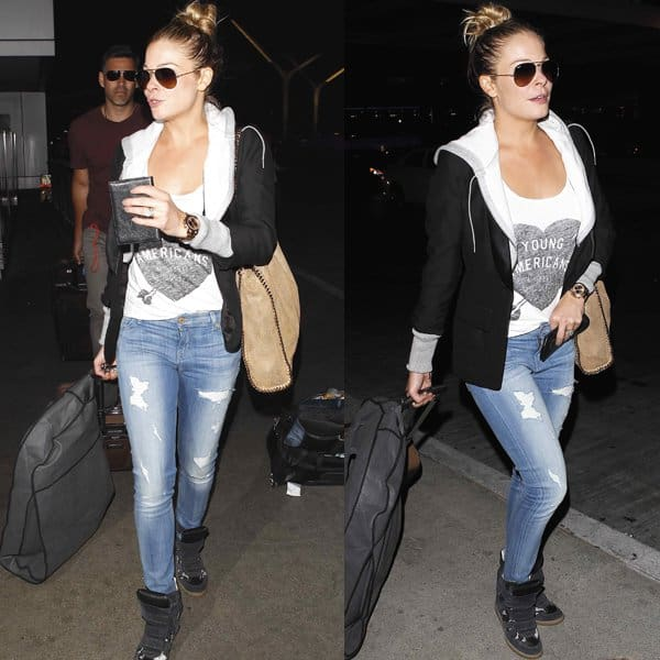 LeAnn Rimes sported a Smythe hoodie blazer and a pair of distressed jeans from 7 for All Mankind