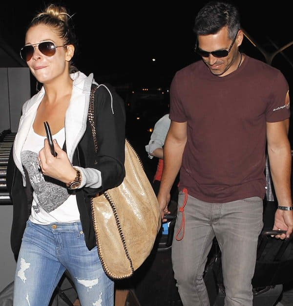 LeAnn Rimes and husband Eddie Cibrian arriving at LAX in Los Angeles on August 28, 2013