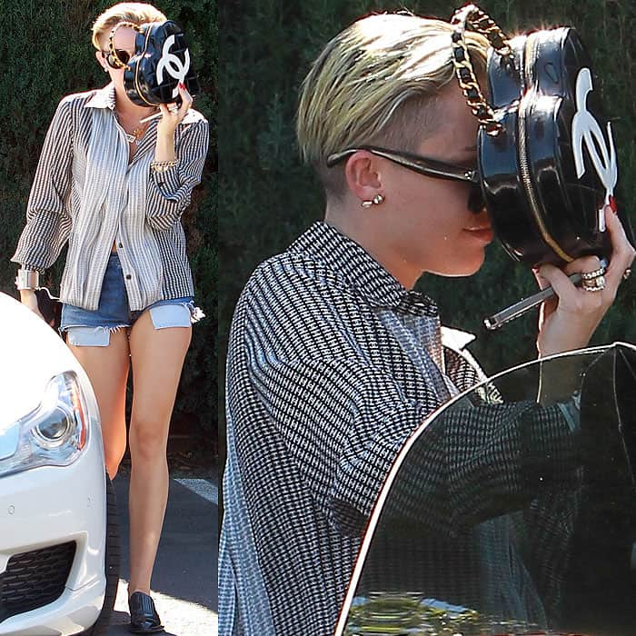 Miley Cyrus was suddenly camera-shy when the paparazzi spotted her arriving at a studio in Los Angeles