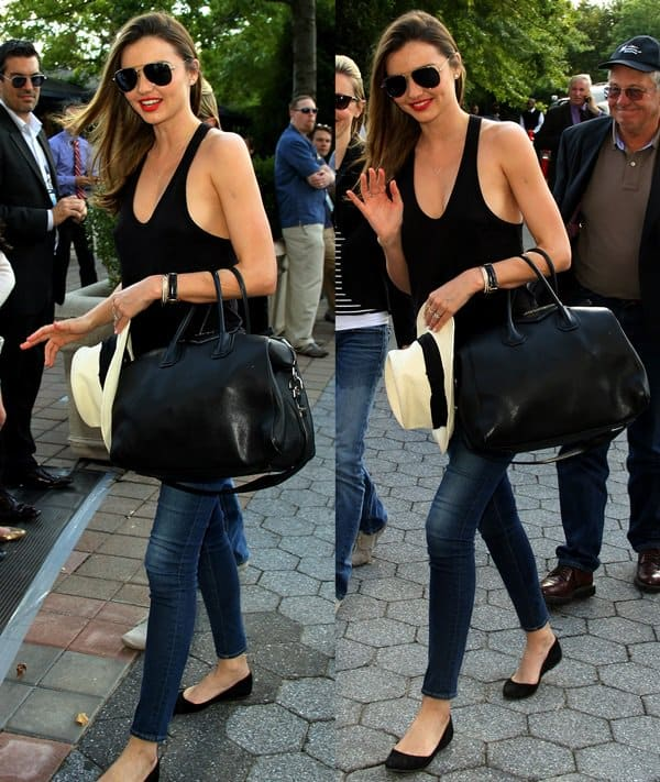Miranda Kerr sported a casual outfit consisting of a black tank top, a black Givenchy handbag, and blue skinny jeans from Frame Denim