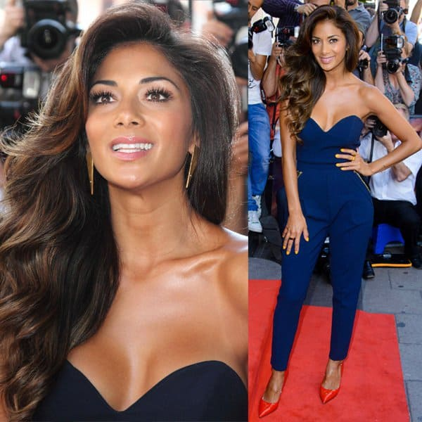 Gold-tone zips and faux leather trim detail the slant pockets of Nicole Scherzinger's navy Three Floor jumpsuit