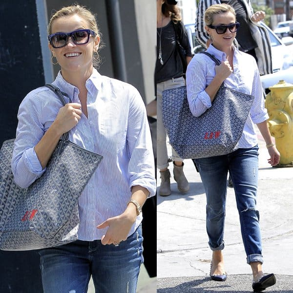 Reese Witherspoon shows off her ripped Black Orchid jeans