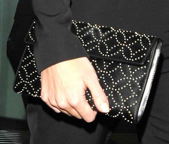 Rosie Huntington toting an Alaia purse