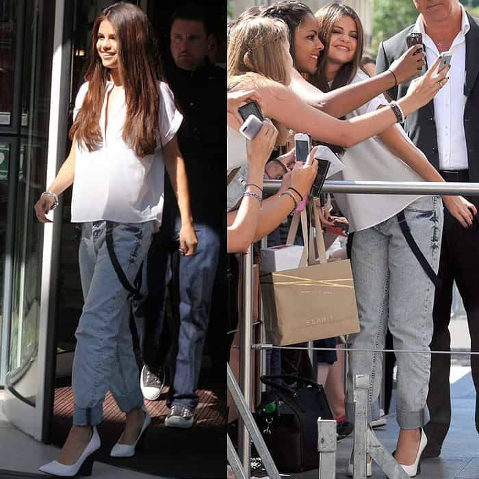 Selena Gomez greeting and posing with fans outside the NRJ studios in Paris, France, on September 5, 2013
