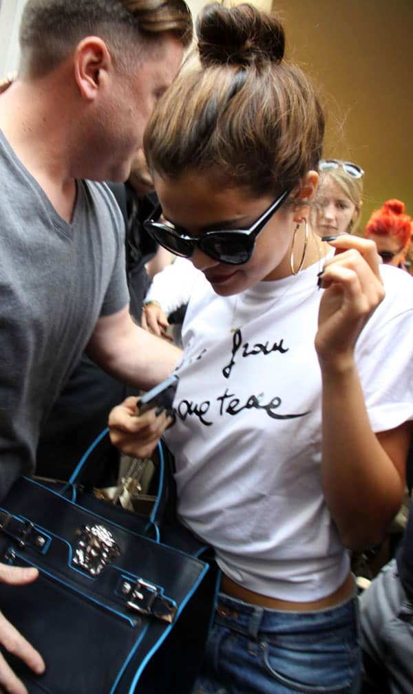 Selena Gomez leaving Versace in a very-appropriate Versace Love from Donatella T-shirt