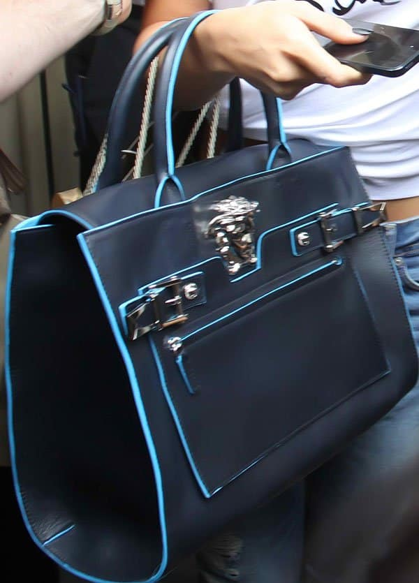 Selena Gomez toting aVersace handbag