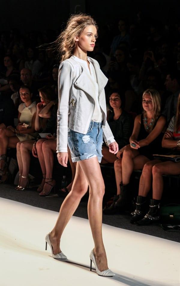 Model wearing Rachel Zoe's distressed denim shorts