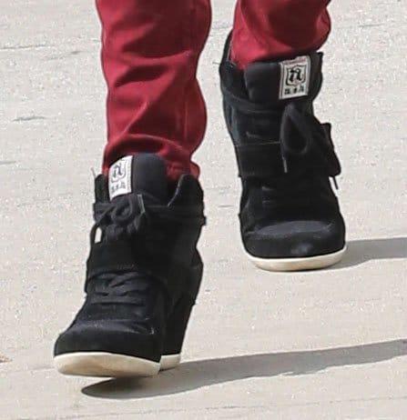 Alessandra Ambrosio wearing black wedge sneakers