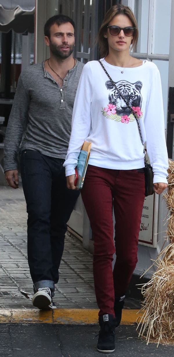 Alessandra Ambrosio with her partner, Jamie Mazur, at the Brentwood Country Mart in Los Angeles on October 8, 2013