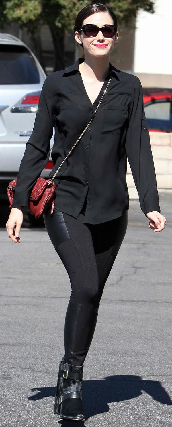 Emmy Rossum wore a pair of ponte-and-leather leggings by Twenty, which she paired with a black button-down top