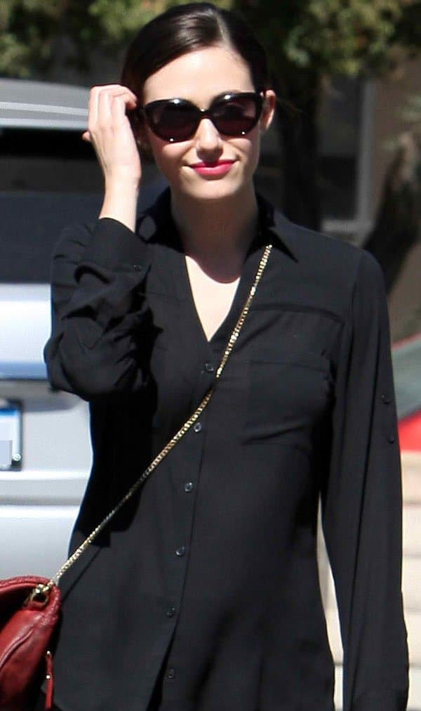 Emmy Rossum put her hair up in a parted updo and slipped a pair of cat-eye sunglasses on to shield her eyes from the afternoon sun