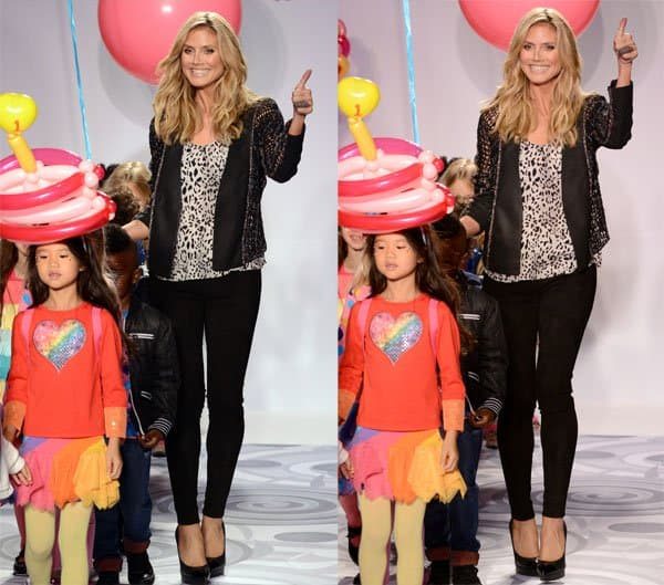 Heidi Klum presenting her holiday line Truly Scrumptious for Babies R Us at the Kids Fashion Week in New York on October 5, 2013