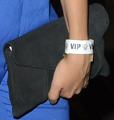 Jade Thirlwall toting a black suede clutch from River Island