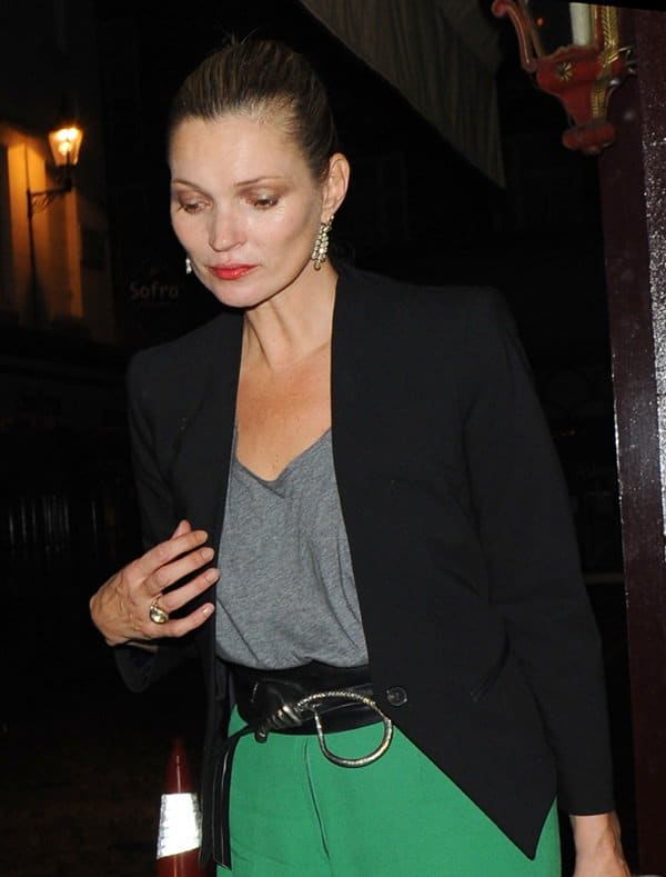 Kate Moss paired her pants with a gray tank top and a tailored black blazer