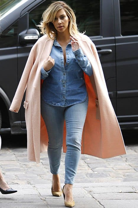 Kim Kardashian made her denim-shirt-and-jeans outfit very much more than worthy of Paris Fashion Week