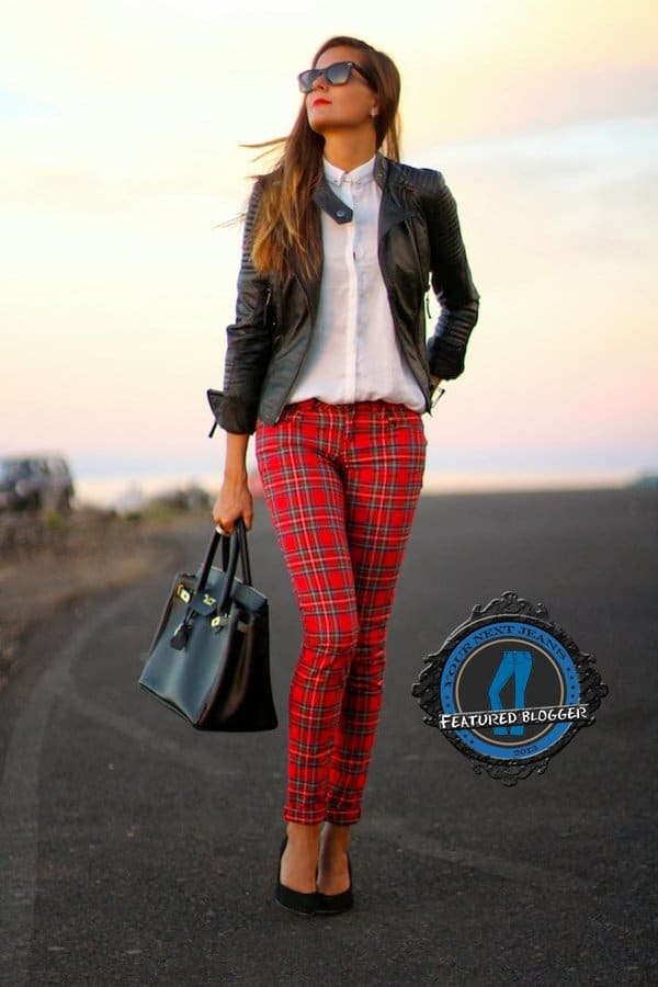 Marianela toughened up her red plaid pants with a leather jacket