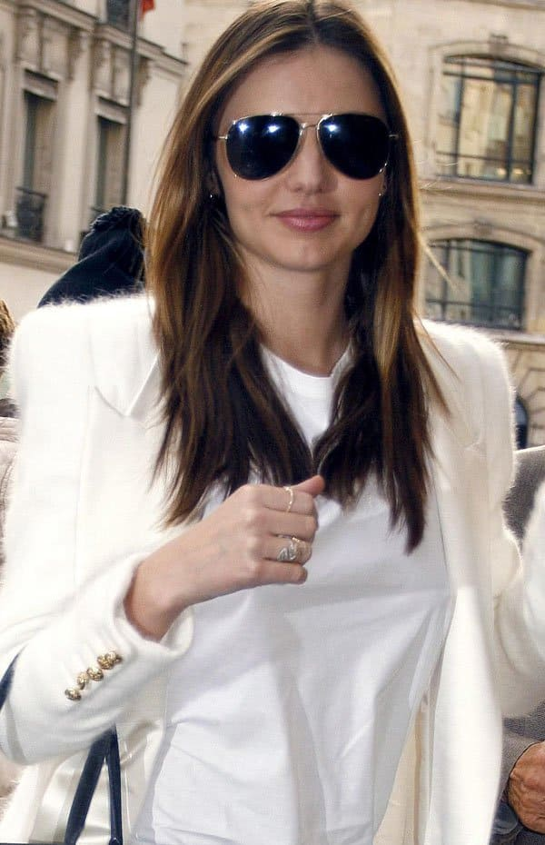 Miranda Kerr was in good spirits as she walked along the streets of Paris