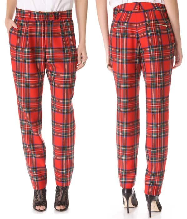 Cut from classic wool tartan and punctuated with polished gold-tone accents, these pleated Preen trousers take on a cool, grunge-inspired element
