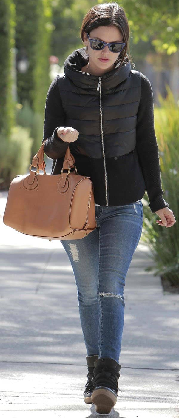 Rachel Bilson all geared up for the cold weather in a fashionable quilted jacket, ripped denims, and wedge sneakers in Los Angeles on October 10, 2013