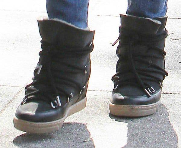 Rachel Bilson wearing black wedge sneakers from Isabel Marant