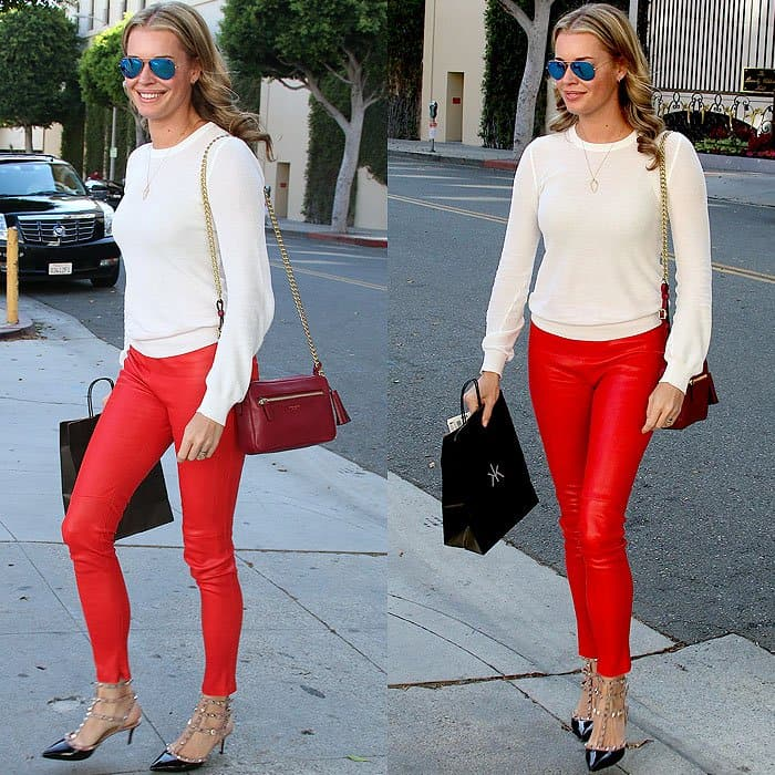 "With her long model legs encased in fire-engine-red leather pants, you can see that Rebecca Romijn doesn't ever need to resort to gimmicks like the ""hand bra"" to make heads turn, hearts beat, and traffic stop"