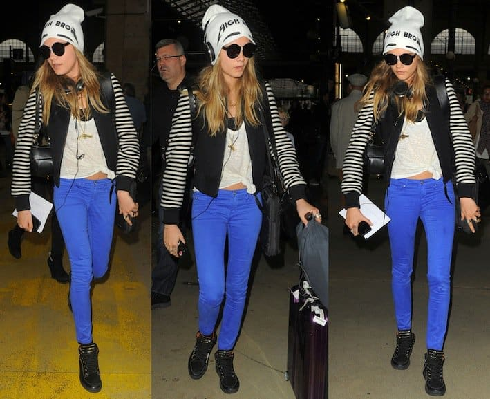 Cara Delevingne styled her electric blue skinny jeans with Mulberry leather and suede high-top sneakers