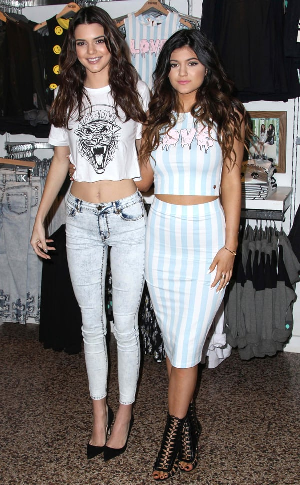 Kendall And Kylie Jenner Launch New Holiday Collection At The PacSun Store in Glendale, California on November 9, 2013