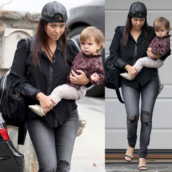 Kourtney Kardashian in Black Orchid