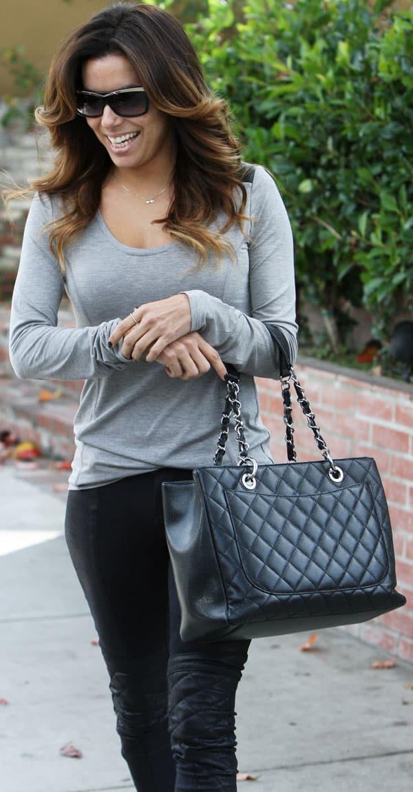 Eva Longoria carries a black quilted Chanel handbag