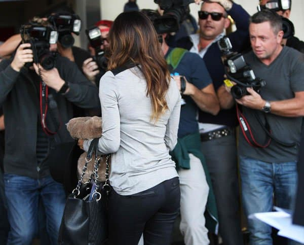 Eva Longoria emerging from the Ken Paves Salon and leaving for LAX