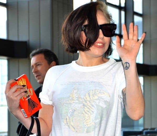 Lady Gaga holding a box of Pocky, a snack food produced by Ezaki Glico